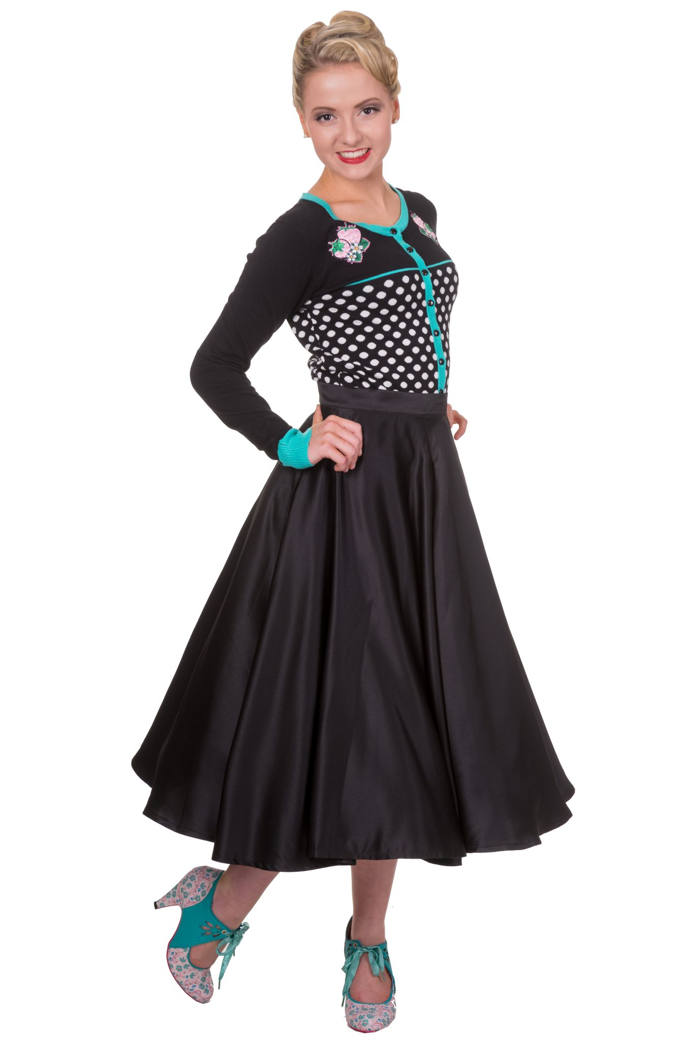 Rockabilly inspired cardigan with polka dot detail and flower embellishments, black satin swing skirt and vintage inspired kitten heels with ties